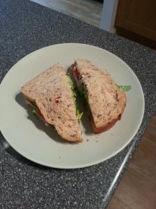 cheese and ham salad sandwich, with salad, coriander and tomato salsa.